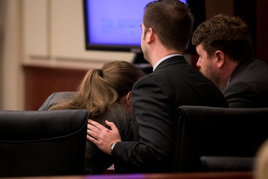 Zachary Walden comforts his client Shayna Hubers, 27, as she cries in his lap before the jury delivers her verdict after five hours of deliberation Tuesday, August 28, 2018 at the Campbell County Courthouse in Newport, Kentucky. Hubers was found guilty of murdering her boyfriend Ryan Poston.