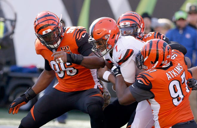 Carlos Dunlap and Geno Atkins collect a sack last year. They both collected extensions with the Bengals on Tuesday.  Mandatory Credit: David Kohl-USA TODAY Sports