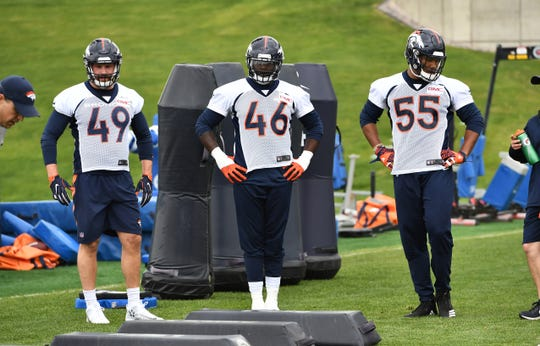 Denver Broncos outside linebacker Marcus Rush (49) and outside linebacker Jeff Holland (46) and outside linebacker Bradley Chubb (55) participates in drills during rookie minicamp at the UCHealth Training Center in May of 2018.