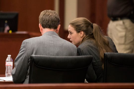 Shayna Hubers, 27, speaks to her attorney David Eldridge before the jury delivers their verdict after five hours of deliberation Tuesday, August 28, 2018 at the Campbell County Courthouse in Newport, Kentucky. Hubers, who was found guilty of murdering her boyfriend Ryan Poston, was granted a retrial after her attorney discovered a juror in the first trial had a prior felony conviction. The juror's 1992 unpaid child support conviction disqualified him from jury duty under Kentucky law.