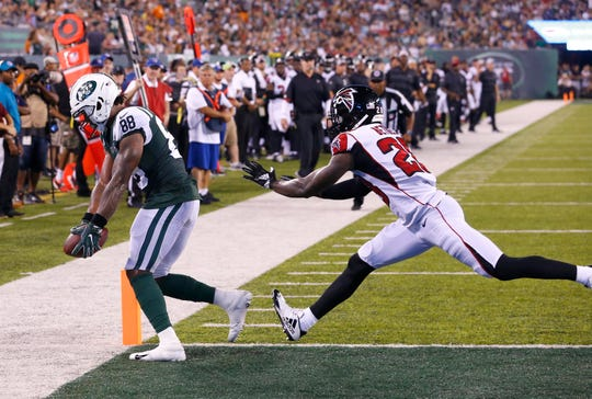 New York Jets wide receiver Charles D. Johnson (88) scores a touchdown against Atlanta Falcons defensive back Justin Bethel (28) during first half at MetLife Stadium on Aug. 10, 2018.