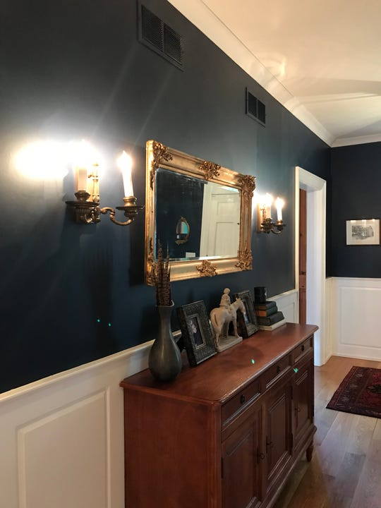 This is a picture of the hallway with heritage color paint and wainscotting.