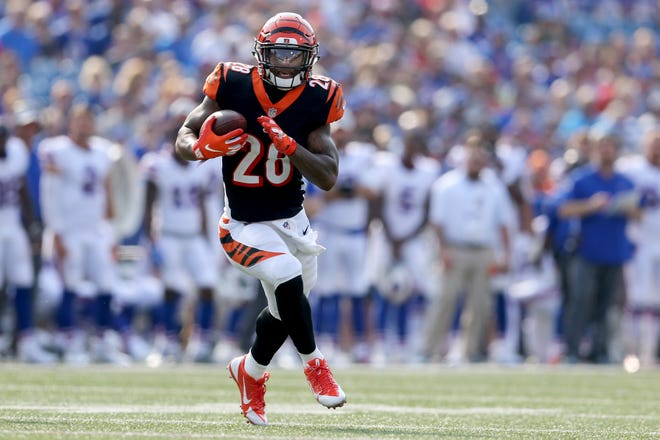 Cincinnati Bengals running back Joe Mixon (28) runs after a reception in the first quarter during the Week 3 NFL preseason game between the Cincinnati Bengals and the Buffalo Bills, Sunday, Aug. 26, 2018, at New Era Stadium in Orchard Park, New York.