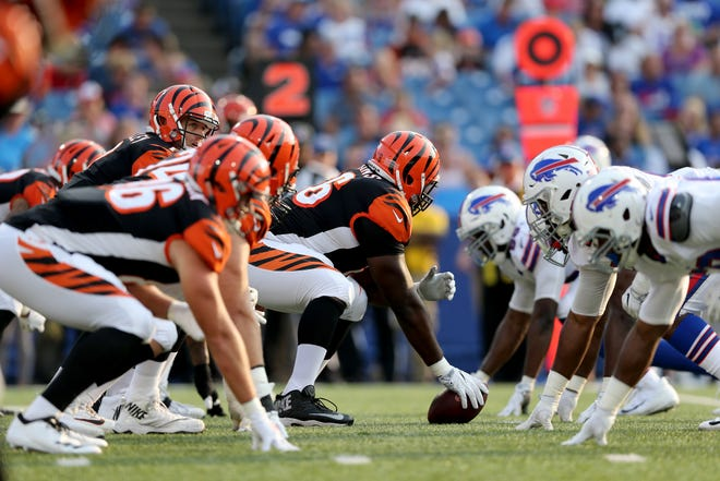 Cincinnati Bengals offensive guard Trey Hopkins (66), playing the center position, and the offensive line get set for a play with Cincinnati Bengals quarterback Matt Barkley (7) under center in the third quarter during the Week 3 NFL preseason game between the Cincinnati Bengals and the Buffalo Bills, Sunday, Aug. 26, 2018, at New Era Stadium in Orchard Park, New York.