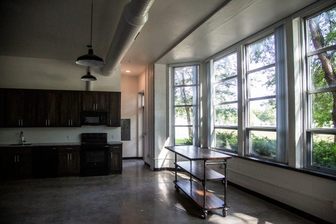 An apartment at the Phenix School Apartments features large windows and high ceilings. The former Phenix Elementary in West Des Moines was recently converted into residential units.