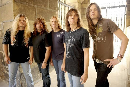 Guitarist Frank Hannon, bassist Brian Wheat, drummer Troy Luccketta, vocalist Jeff Keith and guitarist Dave Rude, members of the band Tesla, will visit Iowa Sept. 7.