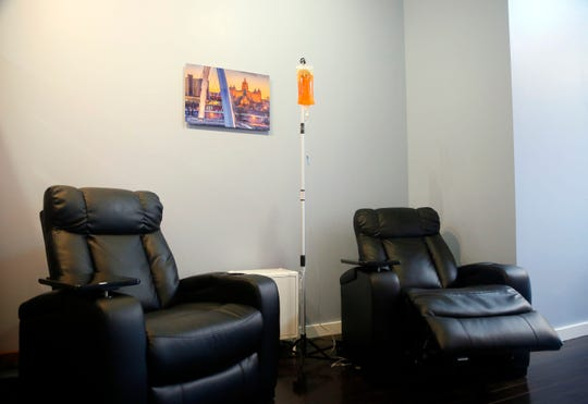 Leather recliners and TVs with wireless headphones create a calming environment at Iowa IV in the Shops at Roosevelt.