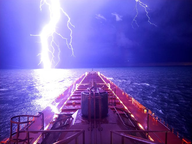 Jack Brandenburg, a mate aboard the Mesabi Miner, captured a dramatic lightning bolt over Lake Michigan on Aug. 28, 2018.