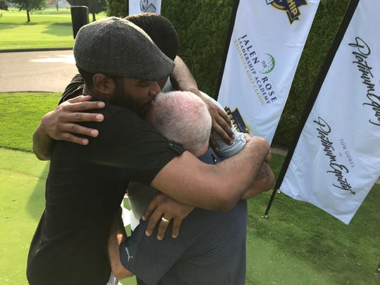 Former Michigan Fab Five members Jimmy King (front) and Jalen Rose embrace their former Wolverines coach, Steve Fisher, at the eighth annual Jalen Rose Leadership Academy Golf Classic at the Detroit Golf Club on Aug. 27, 2018.