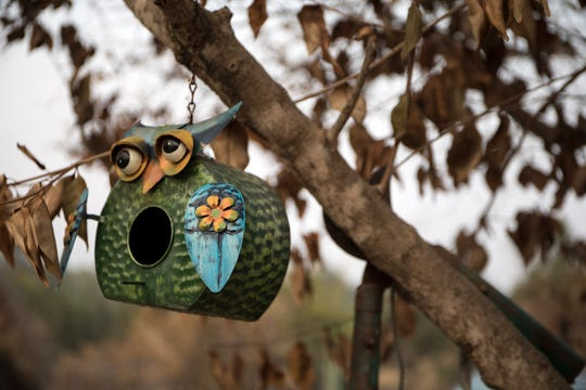 A colorful bird feeder made it through July's Carr Fire tornado on Cactus Lane in Redding, Calif., Saturday, August 26, 2018.