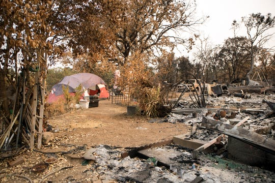 Lynn Adams, 61, lost the home she was renting on Cactus Lane during the Carr fire in July while uninsured and is living in a tent on the property in Redding, Calif., Saturday, August 26, 2018.
