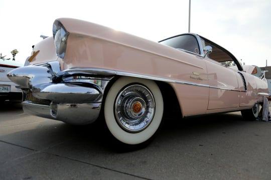 A 1956 Cadillac Sedan Deville, owned by Stuart Popp, is parked in front at the viewing of Aretha Franklin at the Charles H. Wright museum in Detroit on Tuesday, Aug. 28, 2018.