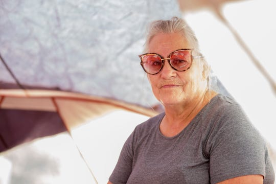 Lynn Adams, 61, who is uninsured, lost the home she was renting on Cactus Lane during the Carr fire in July and is living in a tent on the property in Redding, Calif., Saturday, August 26, 2018.