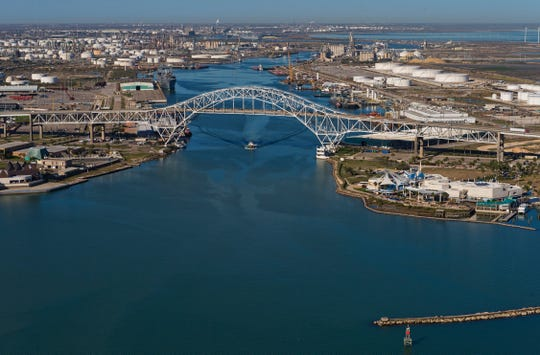 A boat sails under the Harbor Bridge at the Port of Corpus Christi.