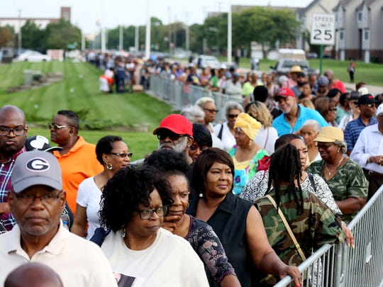 Hundreds wait in line that wraps around the building for the viewing of Aretha Franklin at the Charles H. Wright museum in Detroit on Tuesday, Aug. 28, 2018.