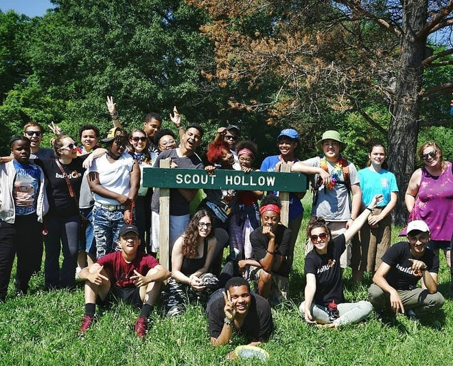 Participants on a summer program that was a collaboration between buildOn and Green Living Science pose outside of Scout Hollow.