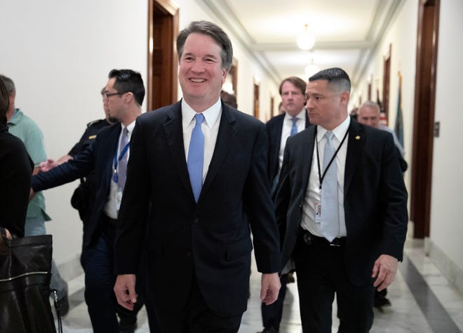 President Donald Trump's Supreme Court nominee, Judge Brett Kavanaugh, departs after meeting with Sen. Chris Coons, D-Del., a member of the Senate Judiciary Committee which will oversee his confirmation, on Capitol Hill in Washington, Thursday, Aug. 23, 2018. (AP Photo/J. Scott Applewhite)