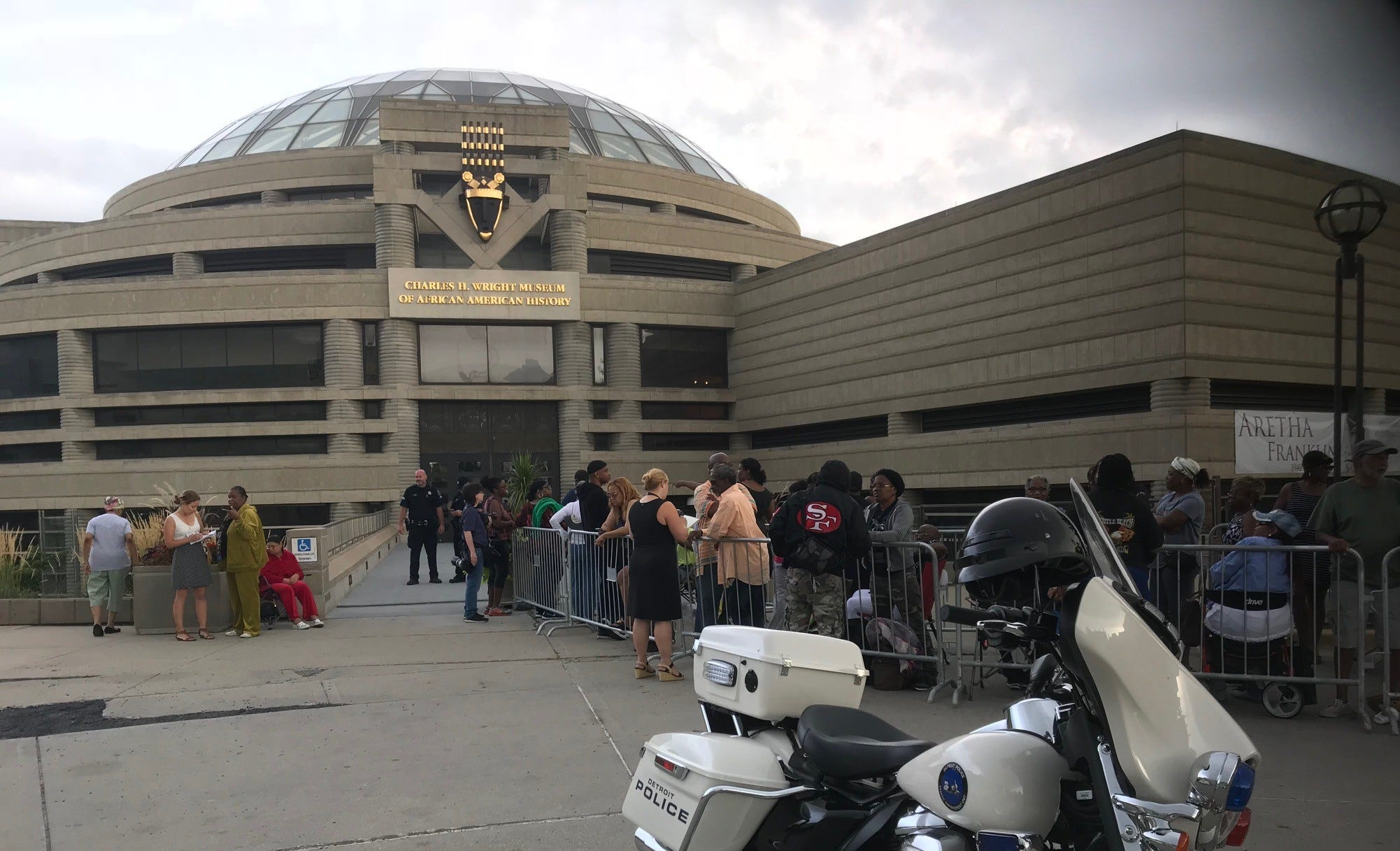 Crowds line up outside the Charles H. Wright Museum of African-American History for the first of a two-day-viewing of the Queen of Soul, Aretha Franklin on August 28, 2018.