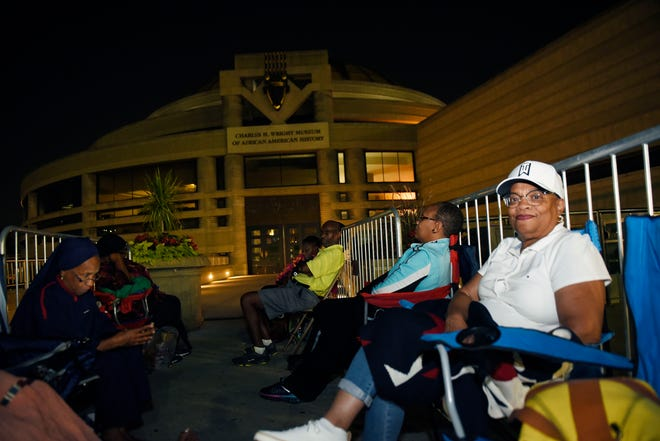 Buena Williams, 68, right, of St. Louis, Missouri, and her sisters Saudah Muhammad, left, of St. Louis and Lisa Scott, also of St. Louis, traveled eight hours to get in line early for Aretha  Franklin's viewing starting Tuesday at the Charles H. Wright Museum of African American History.