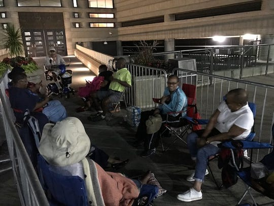 A small group gathered outside the Charles H. Wright Museum of African American History on Monday night to secure early spots before the public viewing for Aretha Franklin.