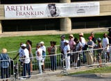 People pay their respects for the Queen of Soul Aretha Franklin as they line up outside the Charles H. Wright Museum  of African-American history to say goodbye.