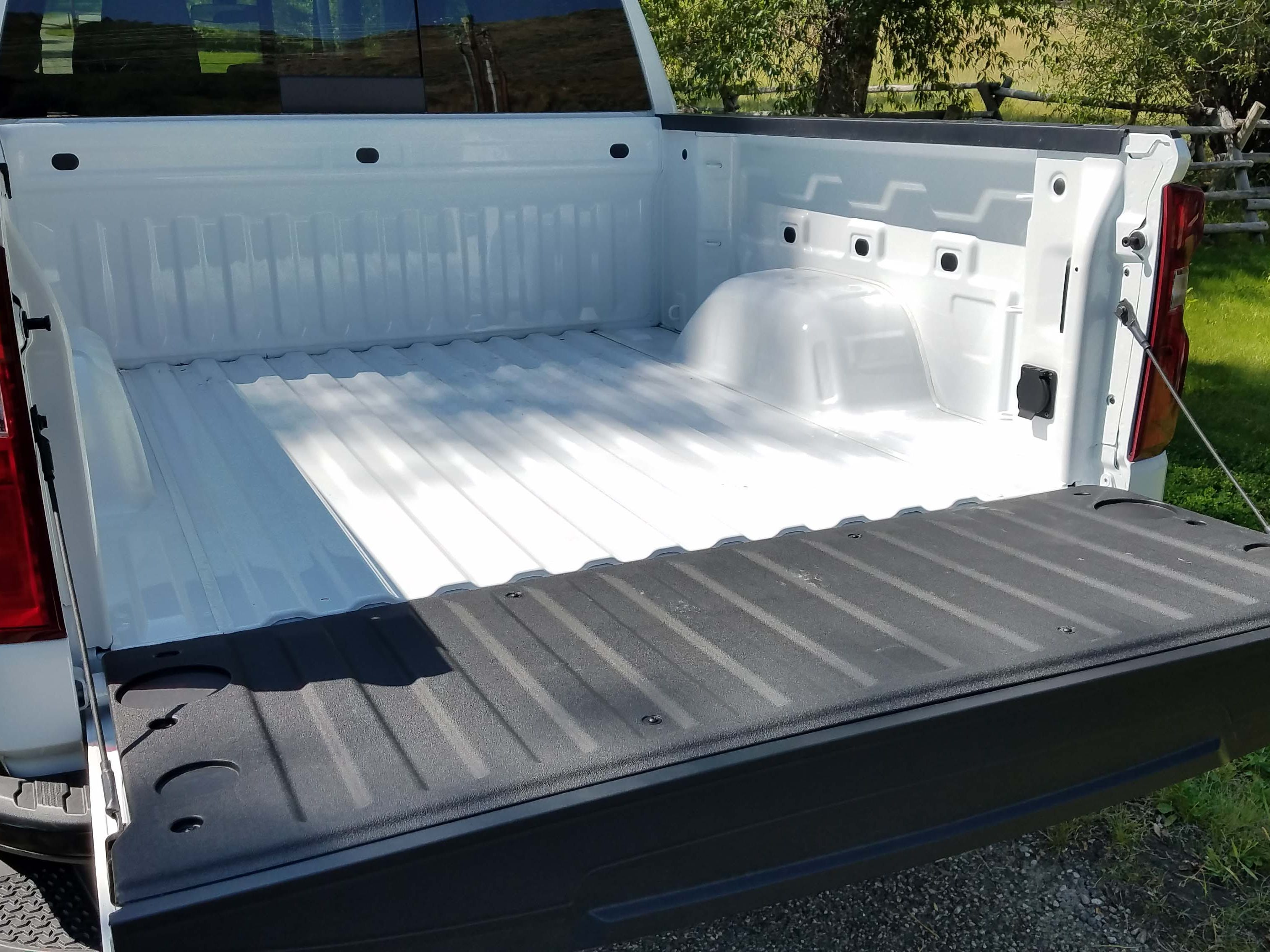 The standard box of the 2019 Chevy Silverado is the largest in its class — increased 7 inches in width by scalloping out the sidewalls. An automatic tailgate — which can be operated remotely — is also available.