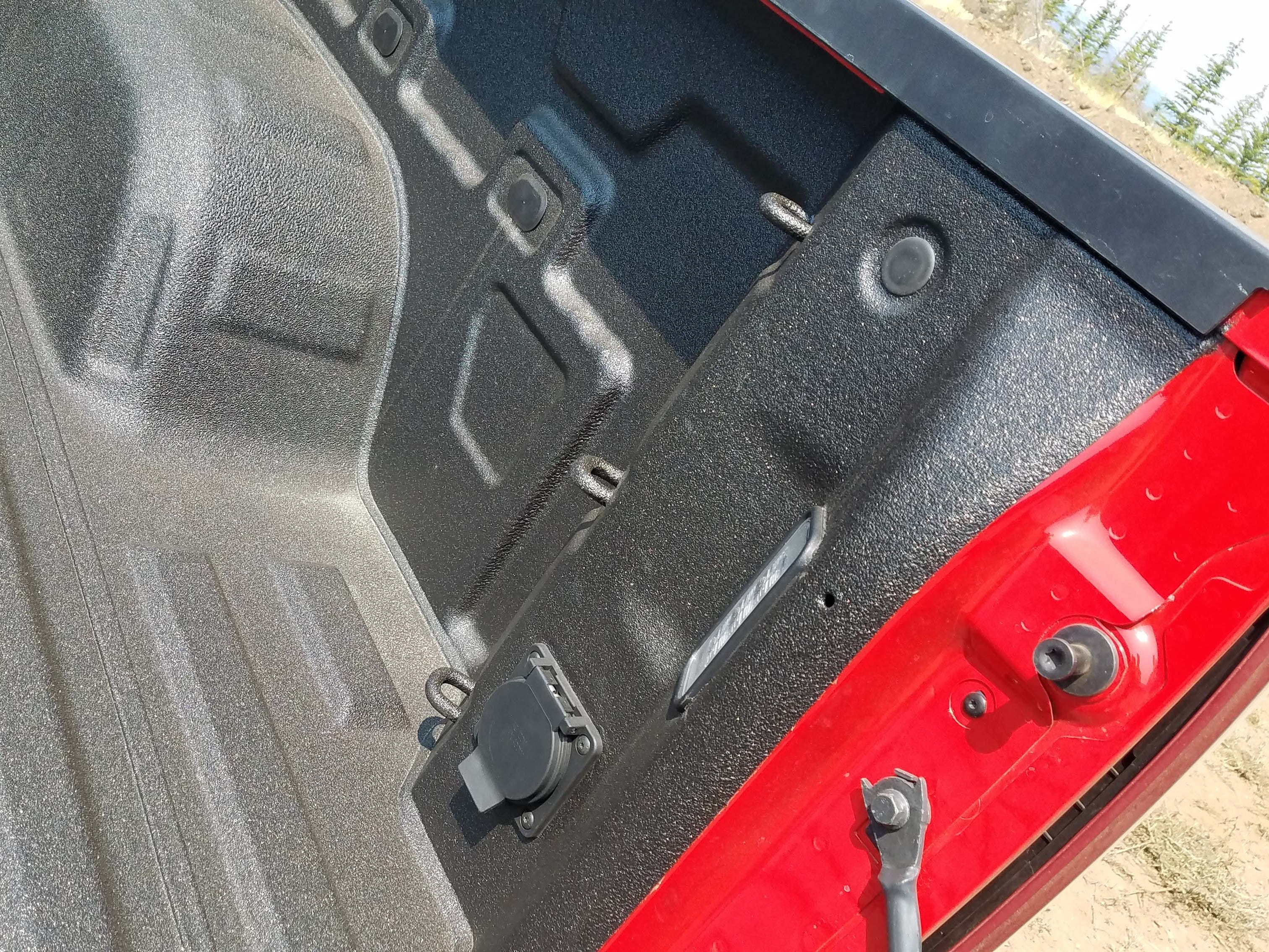The steely 2019 Chevy Silverado bed is not just bigger, but more versatile — the new model adds 12 tie-down hooks.