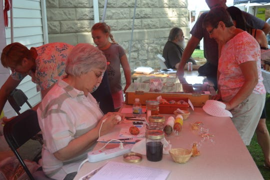 Helen Jean Cooley creates pysanky at the Halupki Festival at Holy Assumption Orthodox Church on August 19, where a constant string of visitors stopped to buy eggs and watch her demonstrate the art.