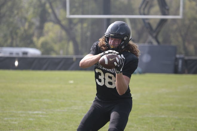 Fossil Ridge graduate Brady Russell walked-on at CU and earned a scholarship in a year. He's now No. 2 on Colorado's depth chart at tight end.