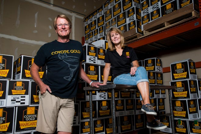 """Coyote Gold Margaritas cofounders Maureen """"Mo"""" Schaffer and Randy Zwetzig are pictured at Coyote Gold's manufacturing plant in Fort Collins, Colo."""