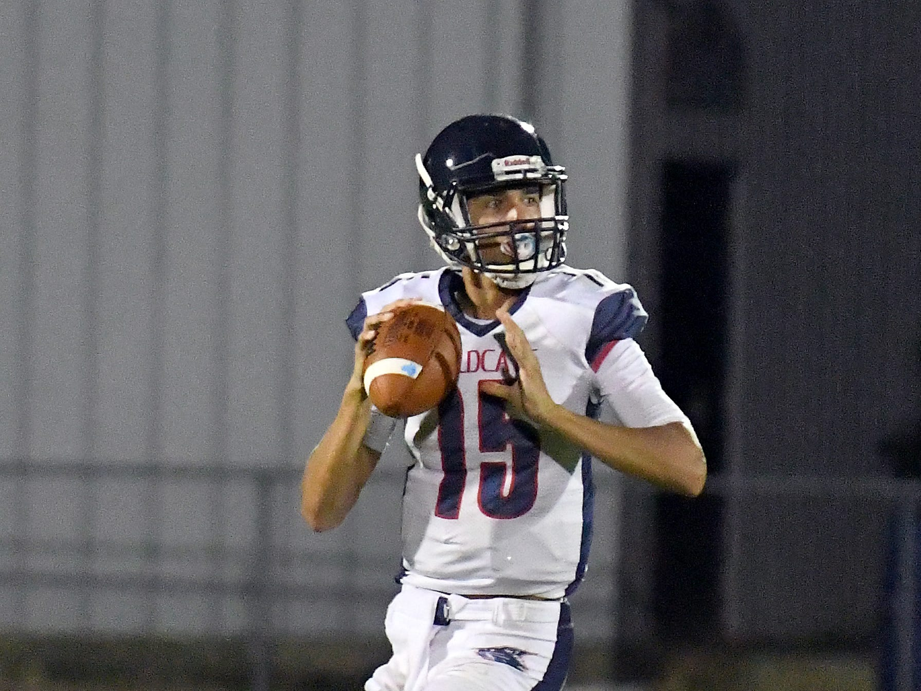 Estero High School quarterback Tanner Elliot (15) drops back for a pass in their game with  Mariner High School in Cape Coral Monday, Aug. 27, 2018.