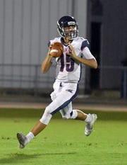 Estero High School quarterback Tanner Elliott (15) drops back for a pass in their game with Mariner High School in Cape Coral last season.
