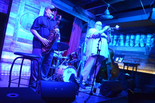Dan Miller (right) and Lew Del Gatto play every Thursday night at The Barrel Room in downtown Fort Myers.