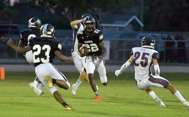 Mariner High School Rashawn Hunter (22) runs the ball up filed in their game with Estero High School in Cape Coral Monday, Aug. 27, 2018.