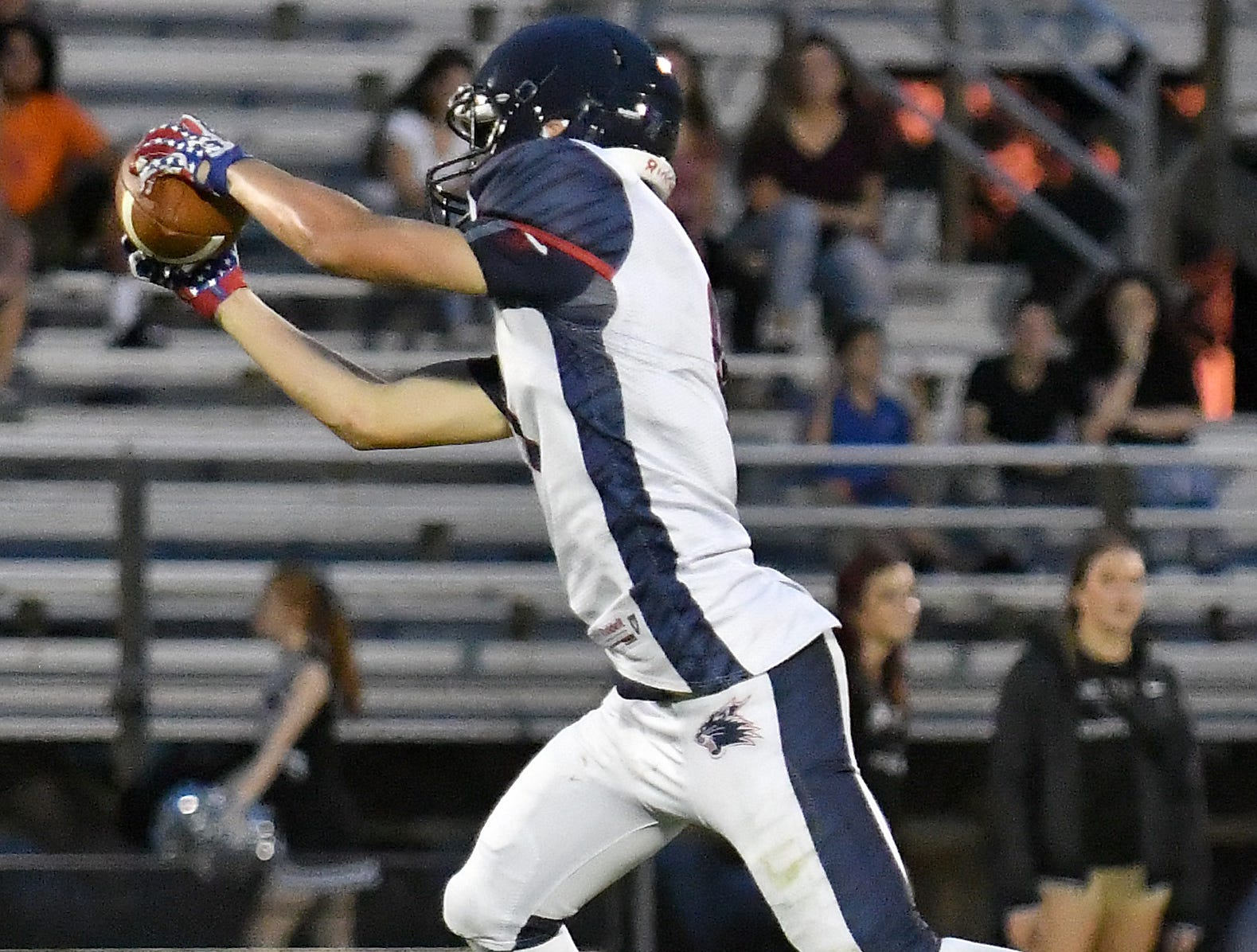 Estero High School wide receiver back Ehan Montgomery (9) catches a pass  during their game with Mariner High School in Cape Coral Monday, Aug. 27, 2018.