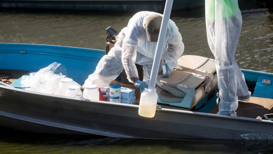Joshua Davidson and Gavin Lau of Egological Laboratories take a water sample from a Cape Coral canal near the Midpoint Bridge on Tuesday 8/28/2018. Cape Coral based Ecological Laboratories has a possible solution to the algae problem that is plaguing Cape Coral and Southwest Florida  waters. They got a letter of no objection to start testing a section of thisl canal that is filled with algae. The process involves a denitrification process.