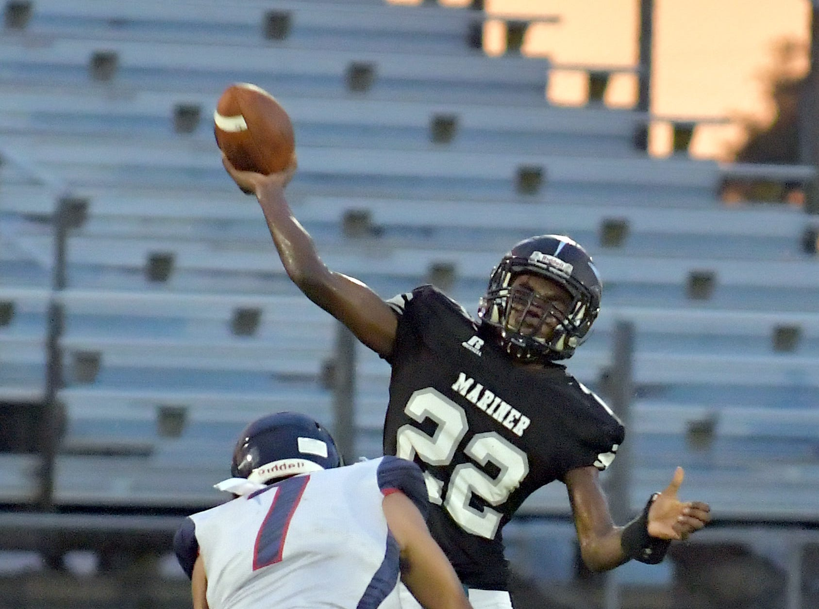 Mariner High School Rashawn Hunter (22) throws a pass over a defender their game with Estero High School in Cape Coral Monday, Aug. 27, 2018.