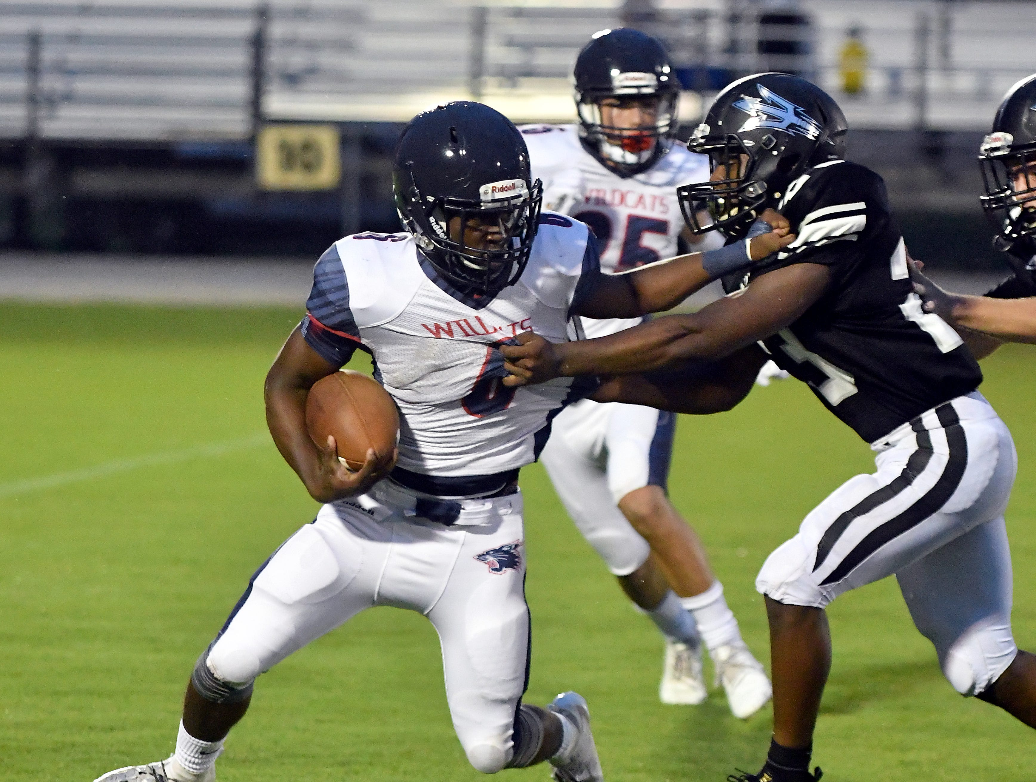 Estero High School running back Derrick Peart (6) tries block a Mariner High School defender during their game in Cape Coral Monday, Aug. 27, 2018.