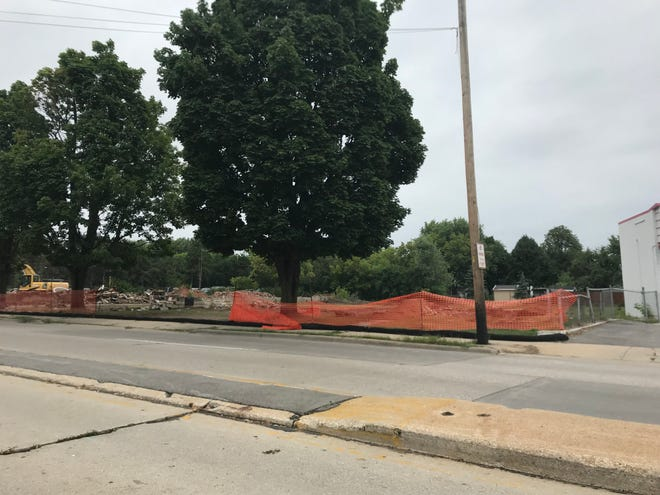 Five homes in the 1300 block of East Mason Street have been demolished, paving the way for Dan Goben Cars to expand its used truck and SUV lot.