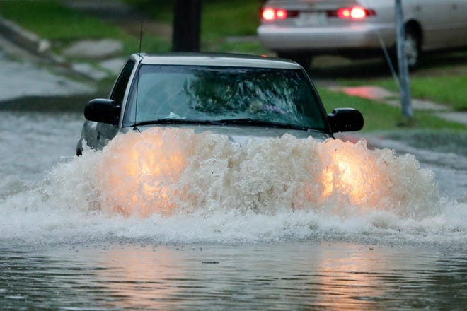 The driver of a small pick up truck bravely pushes through flood waters on Oakland Street on Green Bay's  west side in late September. Heavy rains caused flooding and traffic problems all across northeastern Wisconsin.
