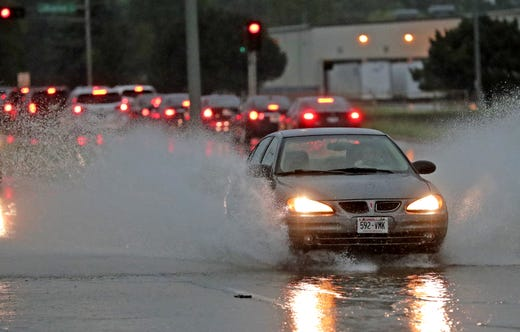Traffic moves west under flooded conditions along Northland Avenue. Tuesday, August 28, 2018, in Appleton, Wisconsin. Dan Powers / USA TODAY NETWORK Wisconsin