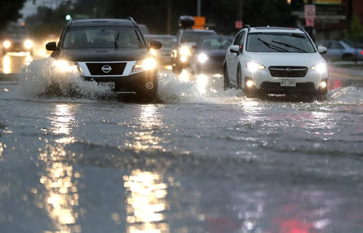 Traffic moves slowly through the flooded intersection of Northland Avenue and Meade Street Tuesday, August 28, 2018, in Appleton, Wisconsin. Dan Powers / USA TODAY NETWORK Wisconsin