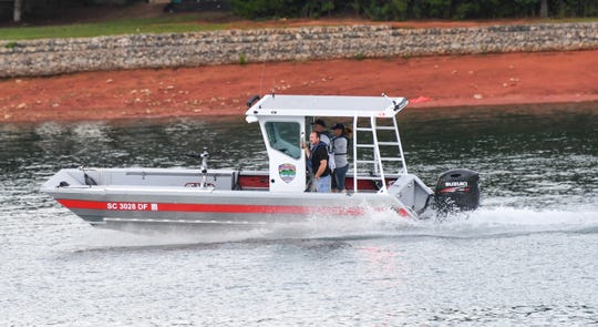 Oconee County dive team go to help emergency rescue workers and divers searching for a man who fell over a boat in Lake Hartwell in 2017.