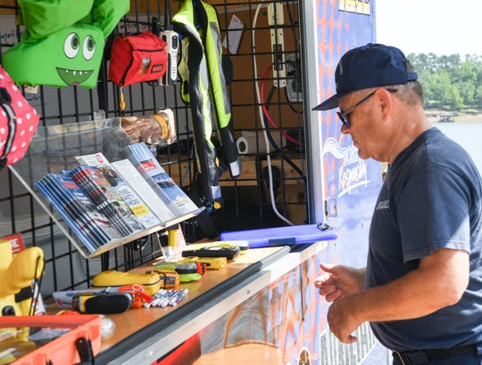 Bruce Lindsey, flotilla commander of the US Coast Guard Auxiliary, helps set up a safety informational trailer during the Meals on Wheels of Anderson County annual Poker Run at Big Water Marina in Starr in 2017.