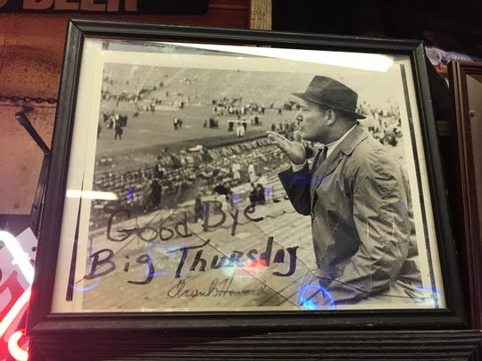 A photo on the wall of Sloan Street Tap Room of legendary Clemson football coach Frank Howard blowing a goodbye kiss to Big Thursday, the traditional schedule for the annual Clemson-South Carolina football game in Columbia.