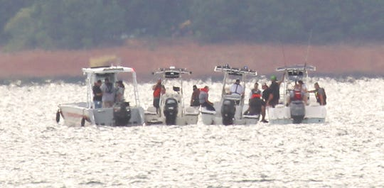 Emergency rescue workers and divers search for a man who fell over a boat in Lake Hartwell in 2017.