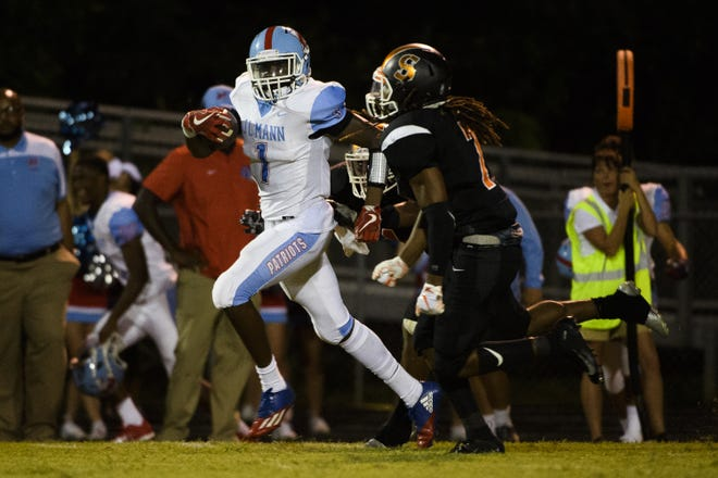 J.L. Mann's Deonte Sloan (1) had seven receptions for 80 yards with one touchdown in the Patriots' season opener against Southside.