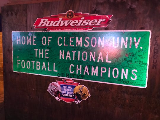 A sign in the Sloan Street Tap Room in Clemson.