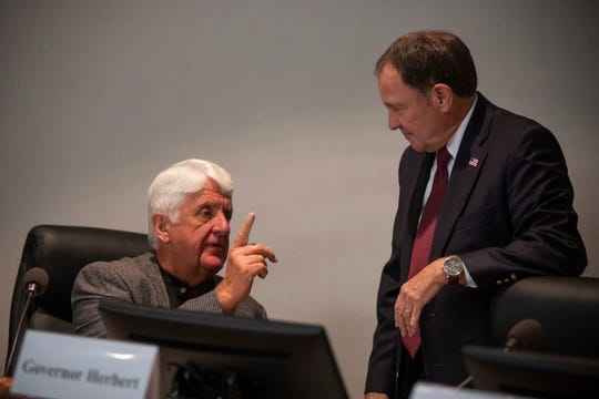 Rob Bishop, U.S. Representative, speaks with Utah Governor Gary Herbert after a roundtable discussion at the Weber County Commission Chambers on reorganizing the Department of Interiors on Tuesday, Aug. 28, 2018, in Ogden, Utah.  (Ben Dorger/Standard-Examiner via AP)