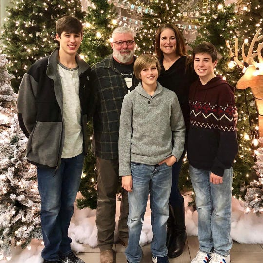 Todd Barbour and his wife, Angie, are pictured last Christmas with their three boys, Tysen, Ayden and Tanner.